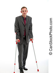 Businessman On Crutches - Smart young businessman in suit...