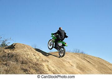 Businessman on Dirt Bike