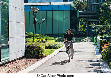 Businessman on electric bicycle