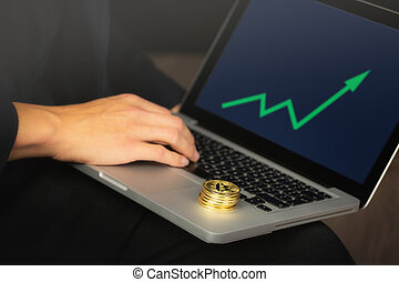 Businessman on laptop with bitcoin coins
