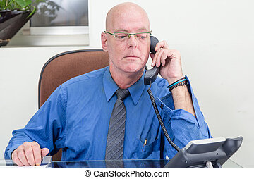 Businessman on phone at desk