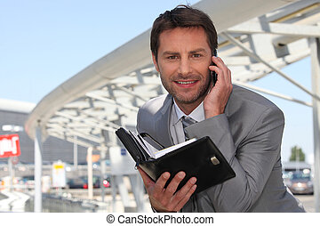 Businessman on phone with diary