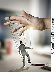Businessman On Strings. Conceptual photography