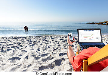 Businessman On the Beach - Businessman on the beach working...