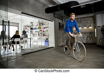 Businessman on the bycicle