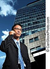 Businessman on the move - Businessman takin a cellphone call...