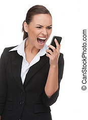 Businessman on the phone. Angry young businessman shouting on the mobile phone while isolated on white