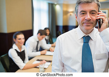 Businessman on the phone during meeting