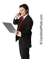 Businessman on the phone hold paper