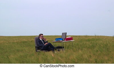 Businessman on the phone in a open air virtual office