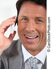 Businessman on the phone smiling