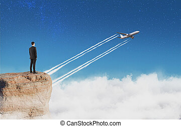 businessman on the rock and plane