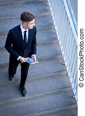 Businessman on the stairs