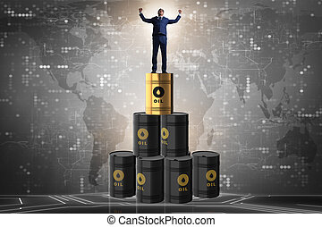 Businessman on top of oil barrels