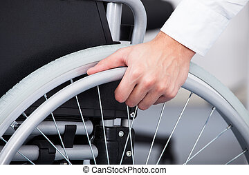 Businessman On Wheelchair - Close-up Of Businessman Sitting...