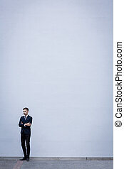 Businessman on white wall