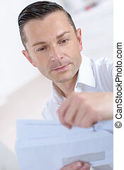 businessman opening a letter