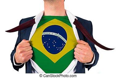 Businessman opening shirt to reveal brasil flag