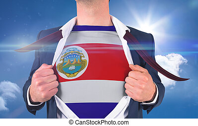 Businessman opening shirt to reveal costa rica flag against bright blue sky with clouds