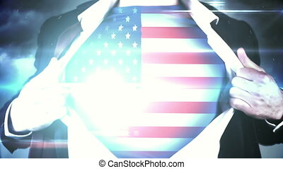 Businessman opening shirt to reveal USA flag on black...