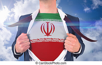 Businessman opening shirt to reveal iran flag against bright...