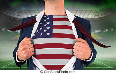 Businessman opening shirt to reveal usa flag against vast...