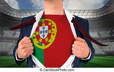 Businessman opening shirt to reveal portugal flag against large football stadium under spotlights