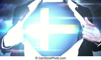 Businessman opening shirt to reveal sweden flag on black...