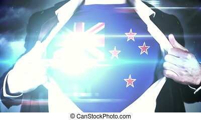 Businessman opening shirt to reveal new zealand flag on...