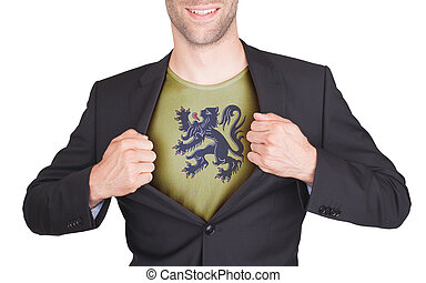 Businessman opening suit to reveal shirt with flag, Flanders