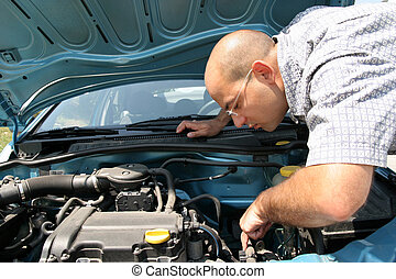 checking the engine of a car