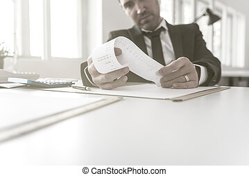 Businessman or accountant checking a printout