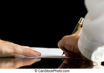 Businessman or attorney signing a document, contract or...