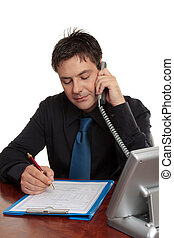 Businessman or doctor filling out form