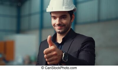 Businessman or factory manager give thumb up , close up shot...
