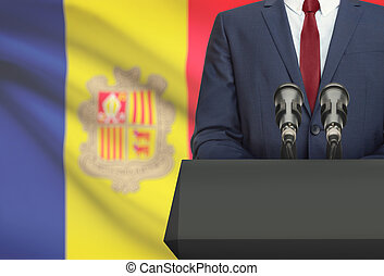 Businessman or politician making speech from behind a pulpit with national flag on background - Andorra