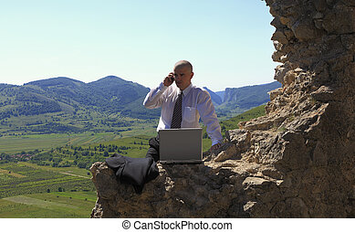 Businessman outdoors - Businessman on the phone in front of...