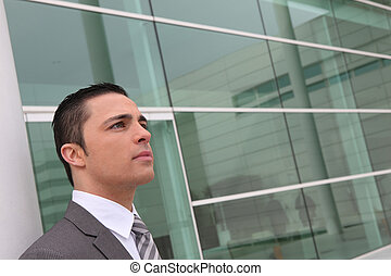 Businessman outside a glass-fronted building