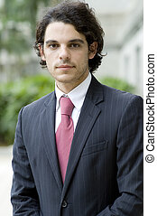 Businessman Outside - A young businessman in jacket standing...