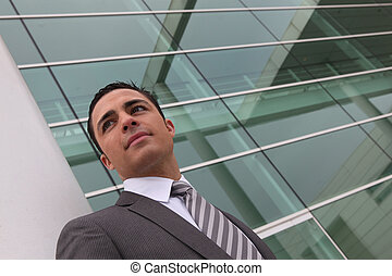 Businessman outside an office building