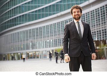 Businessman outside modern building
