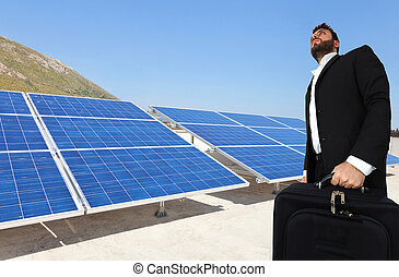 Businessman over big solar panels