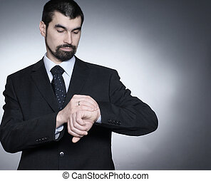 Businessman over dark background