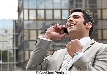 Businessman overjoyed with his phone call