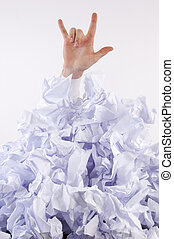 Businessman overwhelmed by paper