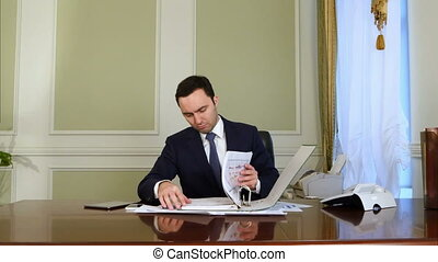 Businessman overwhelmed by paperwork. Professional shot in...
