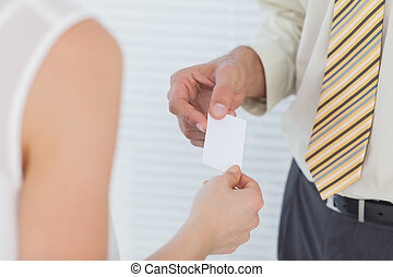 Businessman passing his business card