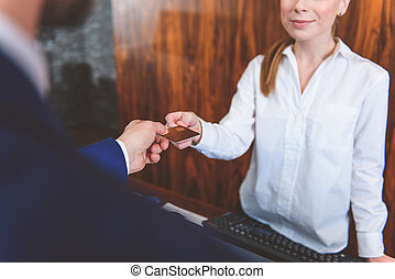 Businessman paying for services in hotel