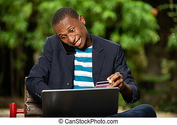 businessman paying with credit card on laptop