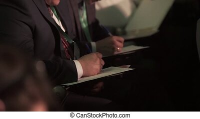 Businessman people write notes at conference